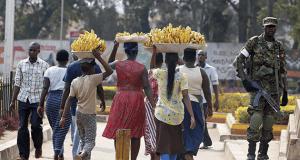 Women carrying baskets of banana in Uganda