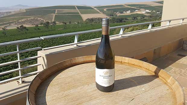 Red wine bottle on restaurant deck at Durbanville Hills