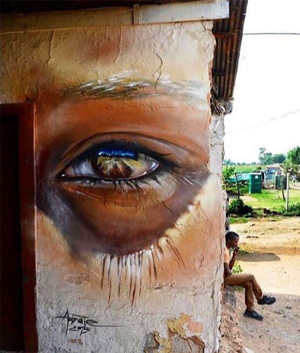 Graffiti of a boy's eye in Johannesburg by street artist Adnate