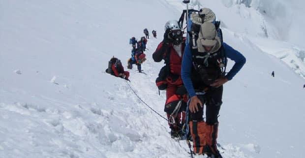 High-altitude climbers trekking through snow