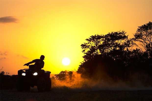 ATV silhouette against sunset