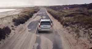 A Volvo plug-in hybrid car driving along the coastline