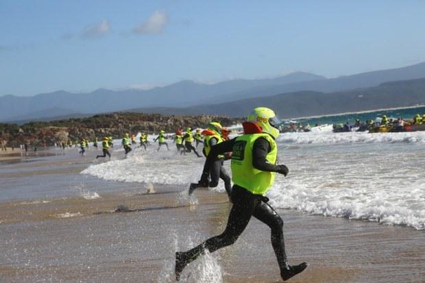 Boat pilots running on beach at start of Aquila Safari Trans Agulhas Challenge