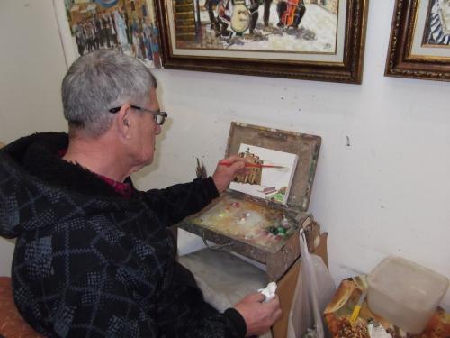 Safed artist Michel Elkayam paints the Western Wall in Jerusalem