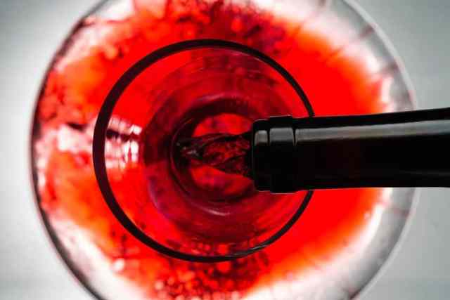 Red wine pouring in decanter