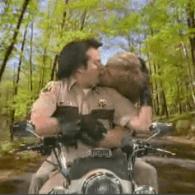 Jon Hamm and Jason Sudeikis Lock Lips On A Hog