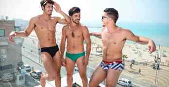 Tel Aviv beach with three men in Towleroad and ManAboutWorld gay travel magazine