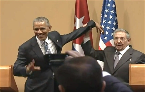 Barack Obama Raul Castro unity pose