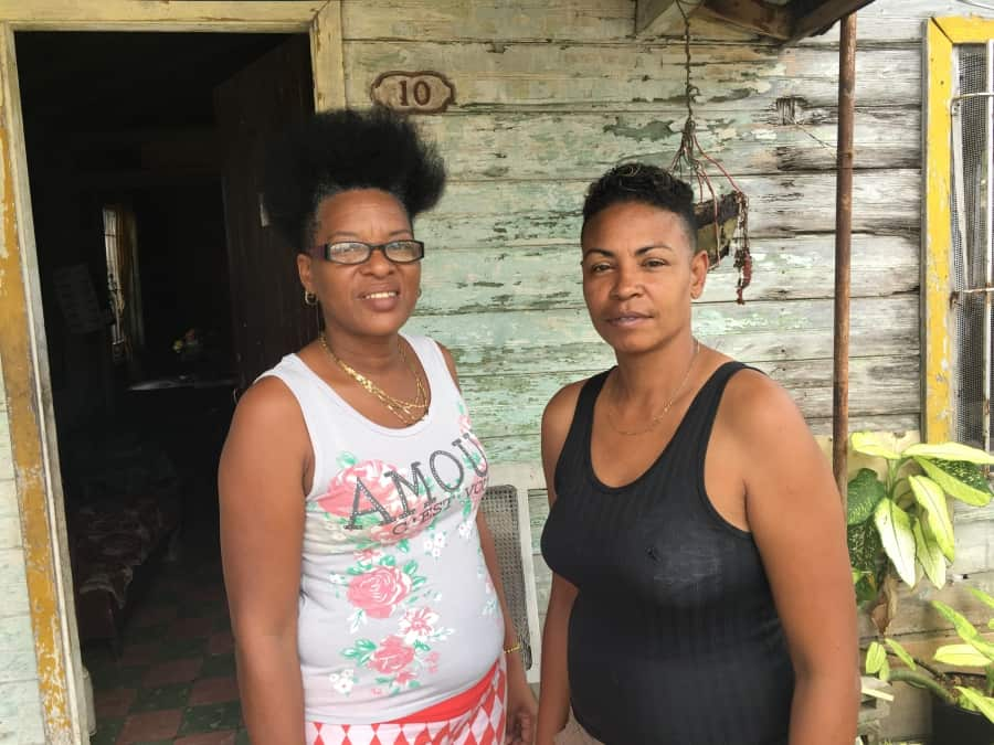 Argelia Fellové Hernández and her partner, Ana, are pictured outside their small home in the outer Havana neighborhood of Mantilla. Credit: Deepa Fernandes