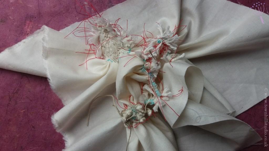 Gathered shibori stitching