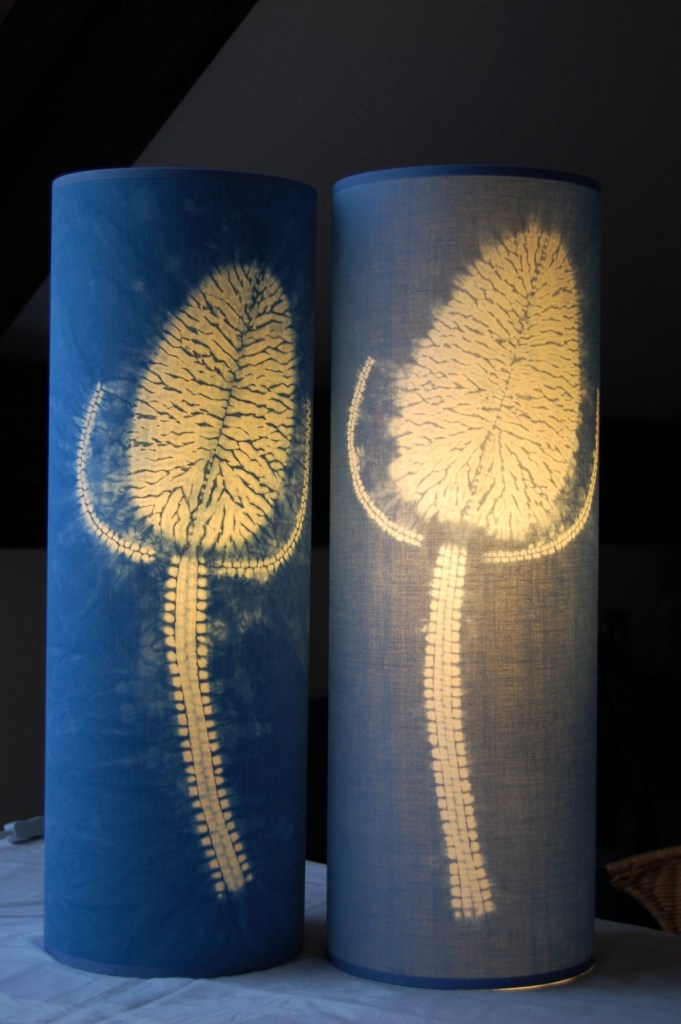 Two teasel lampshades