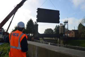 ECS oversee installation of the newly refurbished sluice gate