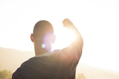 man success hit win triumph