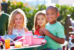children eating lunch - Copyright – Stock Photo / Register Mark