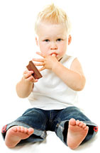 Boy with chocolate - Copyright – Stock Photo / Register Mark