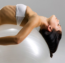 Lady stretching on exercise ball - Copyright – Stock Photo / Register Mark