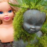 Upcycle dollhead planter