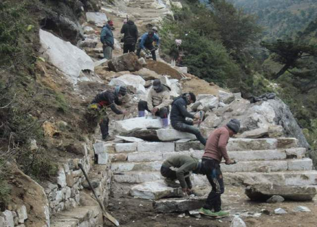 Stone masons improving trail