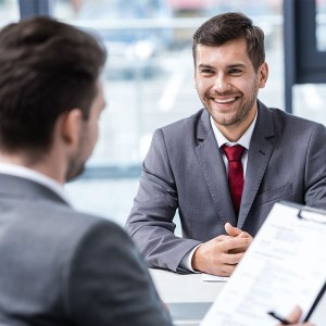 Photo of young professional man dressed in a business suit interviewing for a position