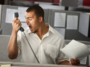 A picture of an employee screaming on the phone.
