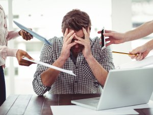 A picture of an overwhelmed employee.