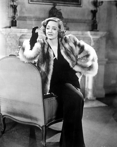 Davis in a later scene. More glamour and authority, but the same woman.