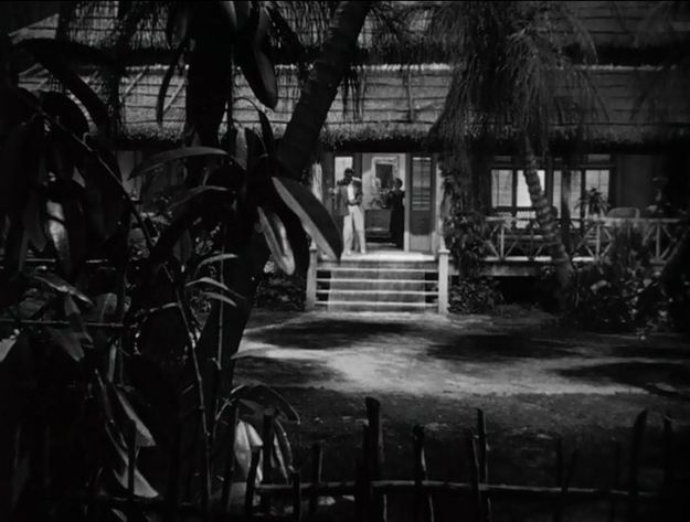 Second gunshot, first sight of Bette Davis as Leslie Crosbie.