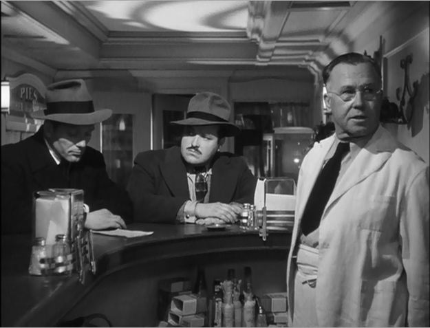 Hired guns Charles McGraw and William Conrad menace lunch counter man Harry Hayden.