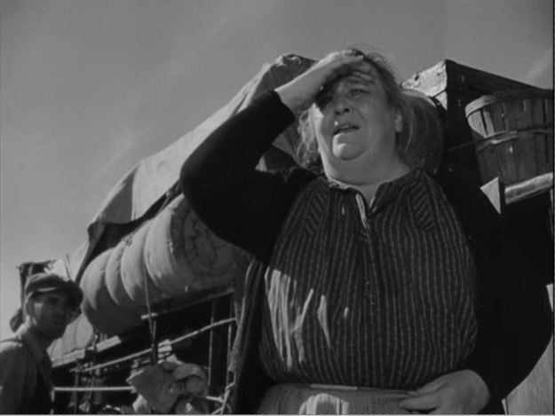 """Jane Darwell: """"A woman c'n change better'n a man. A man lives sorta -- well, in jerks. Grandpa loses a farm, that's a jerk. He dies, and that's a jerk. With a woman, it's all in one flow, like a river, it goes right on. Woman looks at it thata way. An' that's why I et grandpa. My, but I was hungry. All right, then, let's go t'Californy."""""""