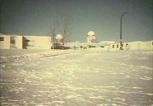 Radar towers seen from down the hill in the PMQ area, CFS Dana, Saskatchewan.