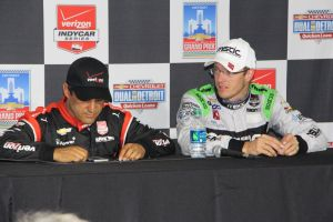 Probably trying to track his next appearance - Indy 500 winners can get pretty busy!  Bourdais looks on!