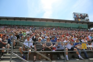Fans watch Ryan Hunter Ray speak at the drivers meeting.