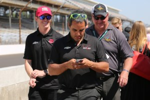 Juan Pablo Montoya work on his phone following the drivers meeting.