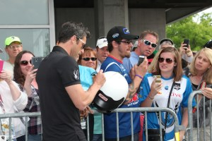 Patrick Dempsey signs autographs for fans.