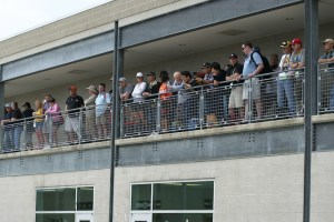 Fans watch the activity in the garage area.