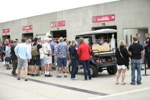 A crowd gathers in the garage area of Rahal Letterman Lanigan Racing.