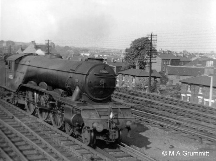 No.60036 Colombo is moving south off the Nottingham line, heading from Grantham shed to New England at Peterborough. It is carrying the headlamp code for a light engine – one lamp at the centre, above the coupling hook. Each locomotive crew was required to have two headlamps aboard as a vital part of their equipment. Here the second lamp would be on the rear of the tender, acting as a tail lamp. It was, and still is, obligatory for every train to show a tail lamp. If a train or a locomotive passes a signal box and there is no tail lamp it will be stopped because it is an indication that the train may have become divided. Photograph by Mick Grummitt.