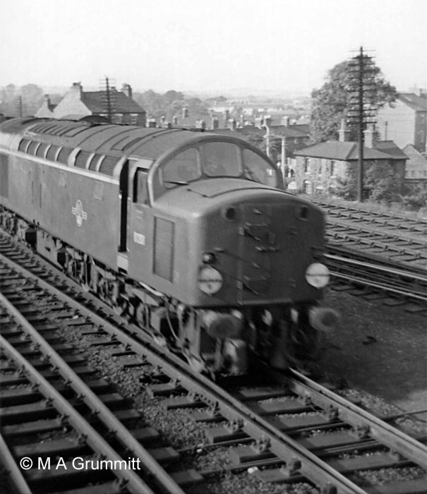 English Electric Type 4 (later Class 40) No. D208 heads south on the Up Main line. It is hauling an express passenger train, denoted by the two white discs, one above each buffer, which for a time were the equivalent of the headlamps used on steam locomotives. Photograph by Mick Grummitt.