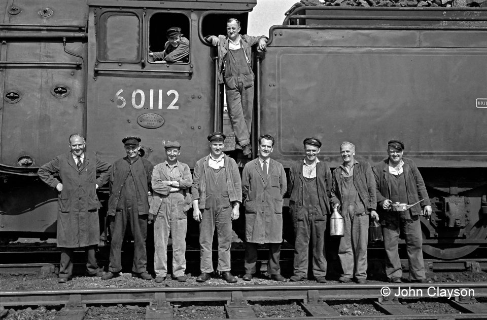 Albert Bellamy was Grantham's shed foreman in August 1963. He is standing on the left of this group of shed staff and footplate crew. Photograph by Cedric A. Clayson.