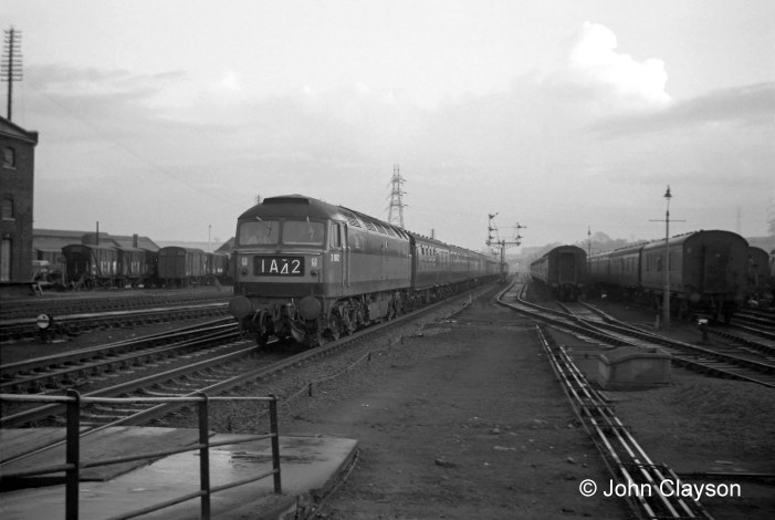This view of 6th February 1966 shows that, in the area controlled by the Yard Box, all points and crossings have been removed from the Down Main line on which the train is approaching. The Down Slow line, to the train's right, is accessed at Grantham South. No.1 and No.2 carriage sidings still appear to be fully occupied. Train 1A42 was the 3pm departure from King's Cross for Newcastle, hauled on this occasion by Brush Type 4 locomotive No.D1982. Photograph by John Clayson