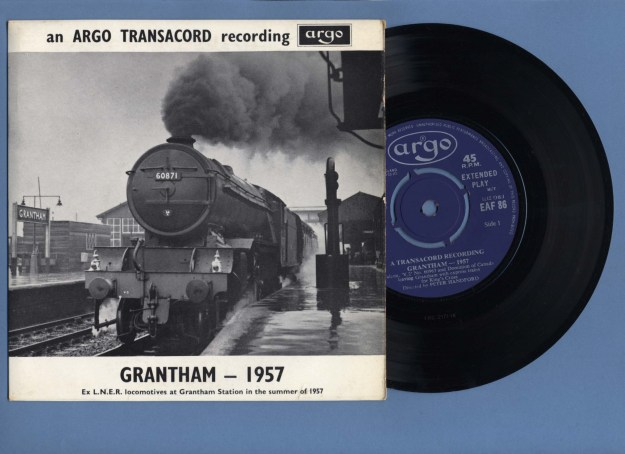 One of Colin Walker's atmospheric photographs aptly illustrates the cover of this 7-inch EP (Extended Play) disc of evocative sounds of the steam railway recorded by Peter Handford at Grantham.