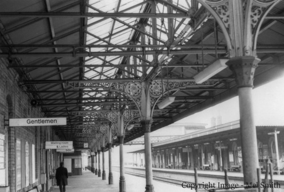 A general view looking south from the northern end of platform 1. The main buildings on platform 2 can be seen on the right across the main lines. Copyright Image - Mel Smith