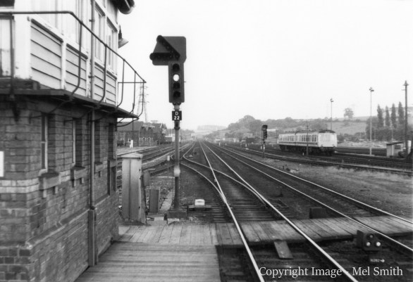 "We are now stood at the end of platform 1 looking south. On the left is Grantham signal box (formerly 'Yard Box'). The colour light signal controls the ""up fast"" to ""up slow"" turnout just beyond. The slow line continued for 5 miles to High Dyke, enabling slower traffic to be overtaken by expresses. Copyright Image - Mel Smith"