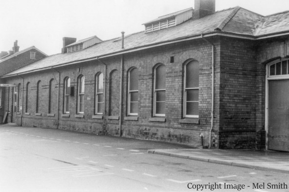 Passing the main entrance we come to the next set of buildings just before entering the Goods Yard which is straight ahead. From right to left the Station Master's Office, the Telegraph Office, a cycle store and the Parcels Office. Copyright Image - Mel Smith