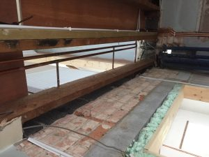View from below of missing floorboards