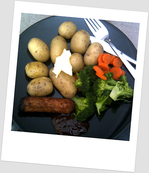 Dinner Day 4: New potatoes, carrots, broccoli and a soya sausage