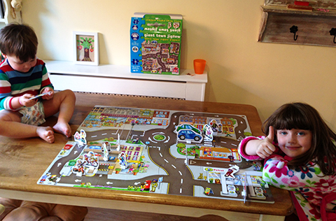 Gabriele And Millisent Learning About Road Safety With Their New Jigsaw