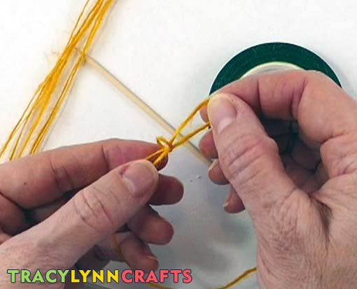 Make a slip knot at one end of the dyed burlap fiber strand