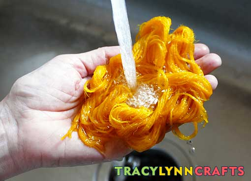 Continue to rins out the turmeric dye until the water runs clear