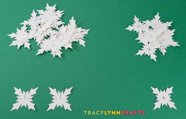 For each snowflake use two of the ones on the left and one of the ones with the plus sign cut in the center